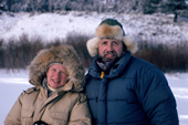 Bryan and Cherry on location in Montana, wearing fur trimmed hoods on their parkas. Montana. USA.