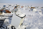 Broken washing machines and other scrap on the rubbish dump at Igloolik. Nunavut, Canada