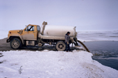 A truck empties a tank of human waste into a sewage lagoon near the Inuit community of Igloolik. Nunavut, Canada.