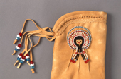 A Cree moosehide glove decorated with beadwork. Northern Quebec, Canada. 1988