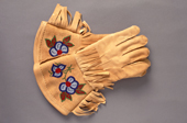 A pair of embroidered Cree moosehide gauntlets. Northern Quebec, Canada. 1988