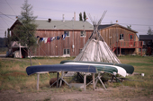 Canoes in front of a lakeside house at the Cree village of Chisasibe, Quebec, Canada. 1988