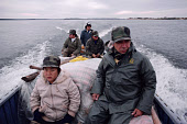 Cree hunter, Josie Sam-Atkinson, and his grandson Tommy Sam set out on an autumn goose hunt. James Bay. Northern Quebec. Canada. 1988