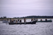 Cree hunters meet up in canoes to discuss tactics on an autumn goose hunt in James Bay, N.Quebec, Canada. 1988