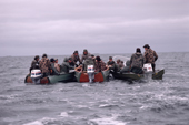 Cree goose hunters discuss tactics on a choppy Hudson Bay. Canada. 1988