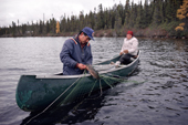 ree trapper Abel Brien and  his wife, Elizabeth, check their fish nets on Lake Bourinot, Quebec, Canada. 1988