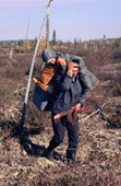 Abel Brien, a Cree hunter, carries his grandson while portaging between two lakes. The Cree. Quebec. Canada. 1988