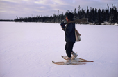 Abel Brien, a Cree hunter wearing snow shoes to aid his walking on a frozen lake. Quebec, Canada. 1988