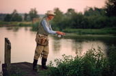 Elderly gentleman fly fishing on the River Test at Kings Sombourne. Hampshire. England
