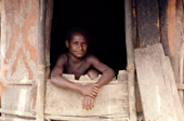 Boy at the door of his hut, Heluk Valley, Irian Jaya. Indonesia. 1990