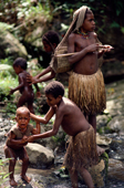 Young Yali girls washing themselves in the river. Irian Jaya. Indonesia. 1990