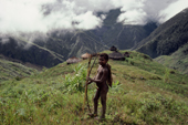 Yali boy with his bow and arrow at Sohopma in the Seng Valley. 1990 Irian Jaya, Indonesia.