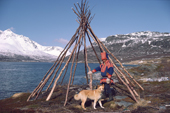 Sami reindeer herder, Aslak, by the frame of his tent / lavvu by summer pastures. North Norway. 1985