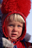 Swedish forest Sami boy in traditional red pom-pom hat at a Spring festival in Kautokeino, North Norway. 1996