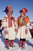 Sami couple wearing traditional clothes at Easter Reindeer races. Kautokeino. Norway. 1996