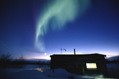 Northern Lights, Aurora borealis over a reindeer herders hut on the tundra. Karasjok. Sapmi. Norway. 2000