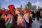 Sami girls congratulate each other after their confirmation service. Sapmi. Karasjok. North Norway. 2000