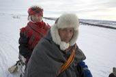Saami reindeer herder, Nils Peder Gaup, and his wife Inge Ellen, out checking their reindeer on a snowmobile. Kautokeino, Finnmark, North Norway. 2007