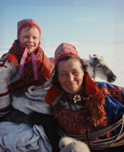 Sitting on a sled, Inga-Anna & her aunt Karen-Anna on a Sami spring migration. Kautokeino. North Norway. 1972