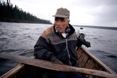 Uniam, an Innu hunter, travelling by canoe on Burnwood lake in Southern Labrador.Canada. 1997