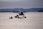 An 'Otter' float plane brings supplies to an Innu autumn hunting camp in Southern Labrador, Canada. 1997