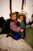 Innu girl with her doll dressed in a traditional baby binding. Labrador. Canada. 1997