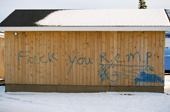 Graffiti against the local police (RCMP) on a building in the Innu community of Davis Inlet. Northern Labrador, Canada. 1997