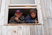 An Elderly Innu couple at the window of their home in Davis Inlet. Northern Labrador, Canada. 1997