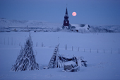 Moonrise over the church in the Finnmark town of Kautokeino in the Polar night. Northern Norway. 1990