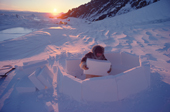 Fur clad Inuk, Qaaviganguaq, builds an igloo. It will be used as a hunting shelter. N.W. Greenland. 1980