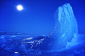Moonlit Iceberg taken at midday during the polar night. Ice polished by the wind. N.W. Greenland. 1980