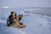 An Inuit hunter, Jens Danielsen, shoots at a seal from the floe edge near Cape York. N.W. Greenland. 1986