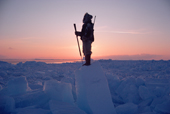 An Inuit hunter scans the ice of Melville Bay for polar bears. N.W.Greenland. 1986
