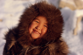 An Inuit girl, Sofie, warmly dressed in a fox fur hooded jacket (kapataq). N.W. Greenland. 1987