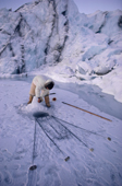An Inuit hunter, Jens, checks his seal net which he sets under the ice. N.W. Greenland. 1987