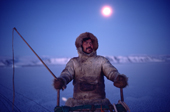 Ituko, an Inuit hunter travelling by dog sled during the polar night. N.W. Greenland. 1987