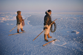 Inuit hunters wait on thin new sea ice for a walrus to surface near them. Siorapaluk. N.W.Greenland. 1977