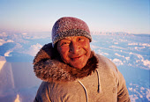 Tukaaq, an Inuit hunter, out on the sea ice in the winter time. Northwest Greenland. 1998