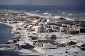 The native community of Uelen is pounded by heavy seas during an autumn storm.Less sea ice in recent years has resulted in more storm damage to the buildings. Chukotka, Siberia, Russia. 2004
