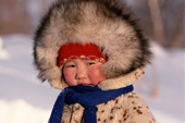 An Evenk girl warmly dressed against the cold. Evenkiya, Siberia, Russia. 1997
