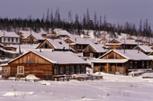 Wooden houses in the Evenk village of Surinda. Evenkiya, Central Siberia, Russia. 1997