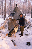 Victor Ivanovich, An Evenk man, with his dog at a reindeer herders' winter camp. Evenkiya, Central Siberia, Russia. 1997