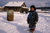 An Evenk boy outside his home in Surinda. Evenkiya, Central Siberia, Russia. 1997