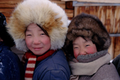 Evenk girls warmly wrapped up against the winter cold. Surinda, Evenkiya, Siberia, Russia. 1997