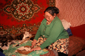 An Evenk woman making a pair of reindeer skin boots. Surinda, Evenkiya, Siberia, Russia. 1997