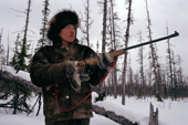 Andrei Dulubchin, an Evenk man out hunting in the taiga. Evenkiya, Central Siberia, Russia. 1997
