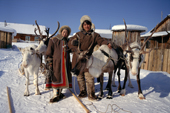 Andrei Konoriornok and his wife Marta, An Evenk couple, with their draft reindeer in Surinda. Evenkiya, Central Siberia, Russia. 1997