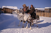 Two young Evenks riding draft reindeer in Surinda. Evenkiya, Siberia, Russia. 1997