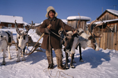 Andrei Konoriornok, an Evenk man, with his draft reindeer in the village of Surinda. Evenkiya, Central Siberia, Russia. 1997