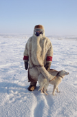 Olga Kirillova, a Sami woman from Lovozero, out on the tundra with her reindeer herding dog, Dik. Murmansk, NW Russia. 2005